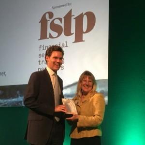 Julia Kirkland presenting a CISI award to a successful candidate