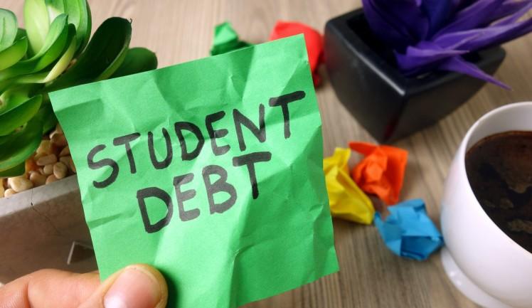 Text student debt handwritten on sticky note